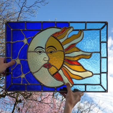 Moon and sun stained glass window copper foil technique. Stained glas class. Paris, Versailles, France.